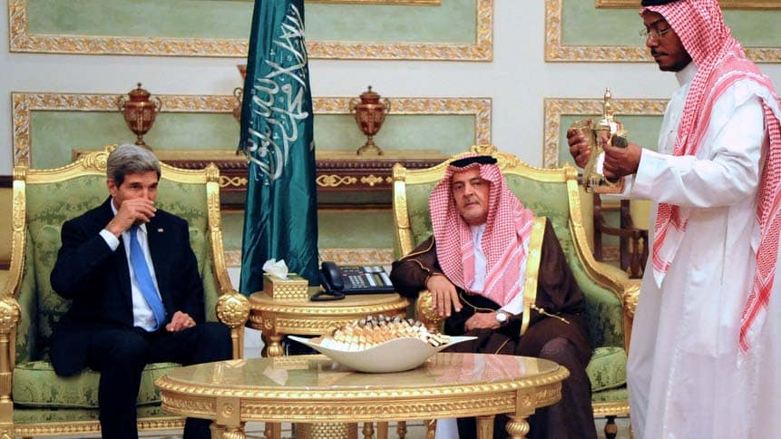 John Kerry, US Secretary of State, served coffee in a formal setting in a Saudi Arabian palace.